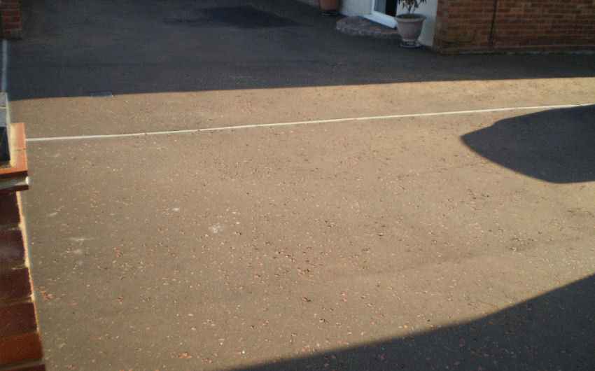 A tarmac with red chip driveway installation