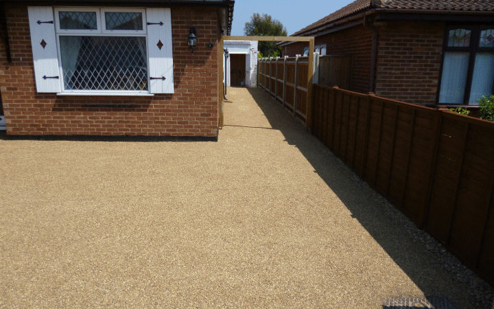 A resin bonded surfacing driveway