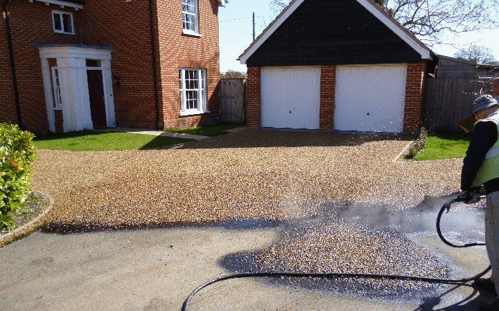 a tar and stone driveway installation