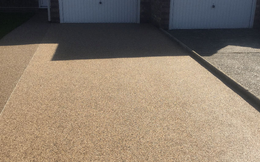 A resin bound surfacing driveway installation